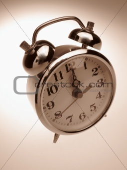 Alarm-clock on light background