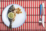 Grilled fish on straw mat