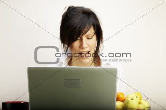 beautiful caucasian woman with laptop singing