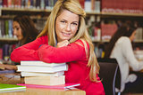 Smiling mature student with stack of books