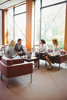 Business people talking and working together on sofa