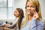 Smiling call centre agent talking on the headset