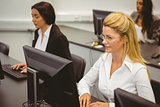 Focused businesswomen working in computer room