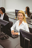 Smiling businesswoman working in computer room