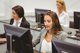 Focused businesswomen working in computer room