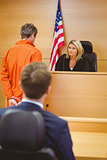 Judge and criminal speaking in front of the american flag