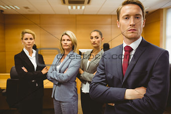 Serious lawyer standing with arms crossed