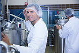 Portrait of a smiling scientist working with brewer