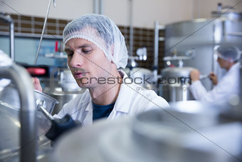Close up of a man wearing a hair net