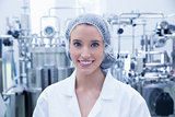 Portrait of a smiling scientist wearing hair net