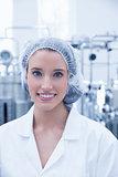 Portrait of a smiling scientist wearing hair net