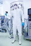 Scientist in protective suit holding ladder