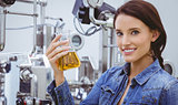 Smiling woman holding a beaker of beer