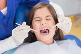 Portrait of a scared young patient in dental examination