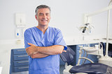 Portrait of a friendly dentist with arms crossed