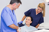 Dentist and nurse introducing a patient