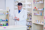 Focused pharmacist writing down notes