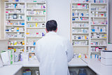 Rear view of a pharmacist working in lab coats