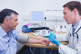 Doctor talking to his patient about his blood pressure