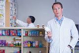 Concentrating doctor holding medicine jar