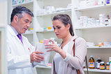 Pharmacist explaining medicine to his customer