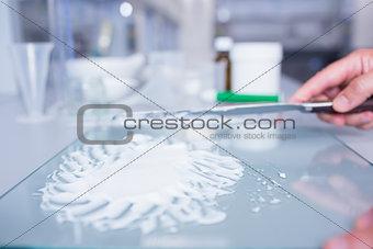 Close up of a biochemist preparing some medicine