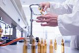 Close up of a biochemist sealing a vial