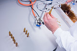 Close up of a biochemist sealing a vial