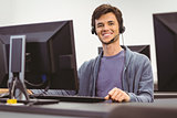 Student sitting at the computer room wearing headset