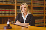 Serious lawyer looking at camera with arms crossed