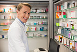 Handsome pharmacist using the computer