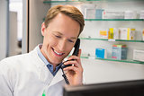 Happy pharmacist on the phone
