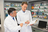 Team of pharmacists looking at clipboard