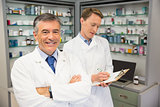 Senior pharmacist smiling at camera