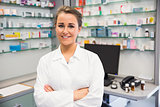 Junior pharmacist smiling at camera