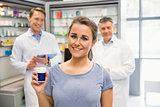 Happy customer holding her medicine