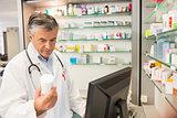 Senior pharmacist using the computer