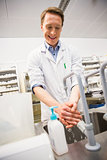 Pharmacist washing his hands at sink