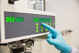 Pharmacist using machinery to make medicine