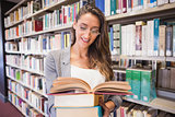 Pretty student reading books in library