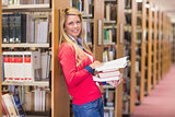 Mature student standing in library