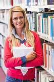 Mature student in library smiling at camera
