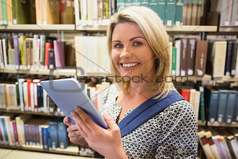 Mature student using tablet in library