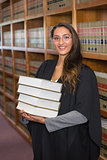 Pretty lawyer looking at camera in the law library