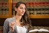 Pretty lawyer reading in the law library