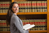 Lawyer looking at camera in the law library