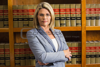 Lawyer looking at camera in law library