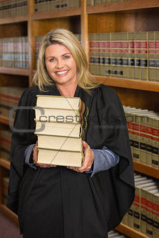 Lawyer holding books in the law library
