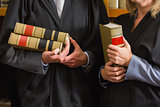 Lawyers holding books in the law library