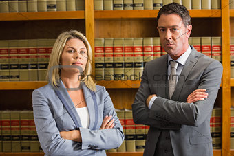 Lawyers looking at camera in the law library